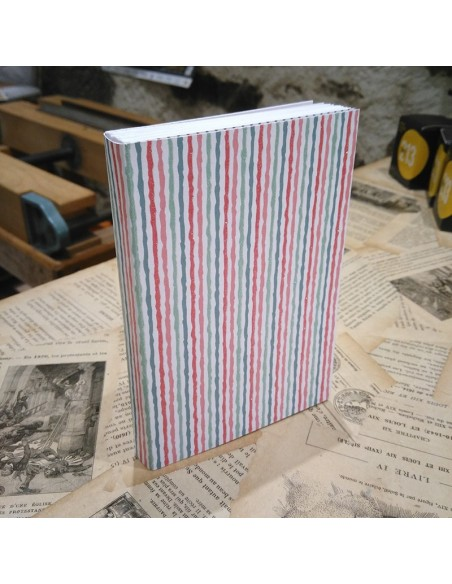 Notebook does but. Striped blanket.
