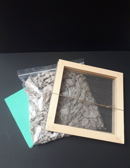 Wooden frame sieve to pass the paper pulp. Sachet of handcrafted paper pulp. Sponge.