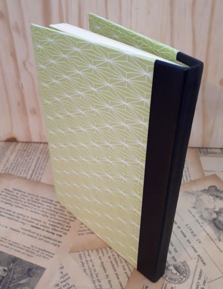 Handcrafted phone book. Green fancy paper leather back.