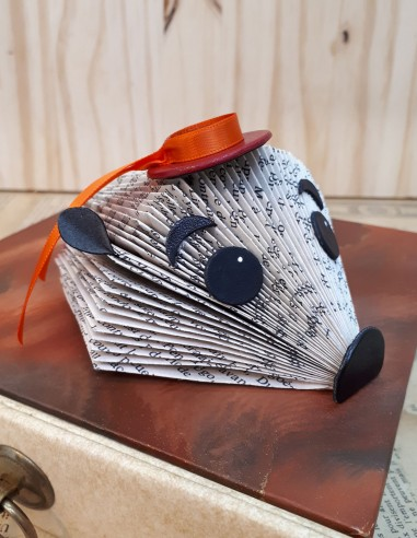 Baby hedgehog handcrafted from a paper book wearing a boater hat.
