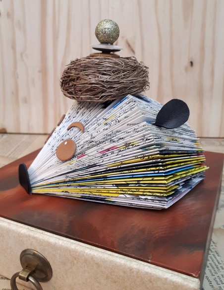 Paper hedgehog house decoration with bird's nest hat.