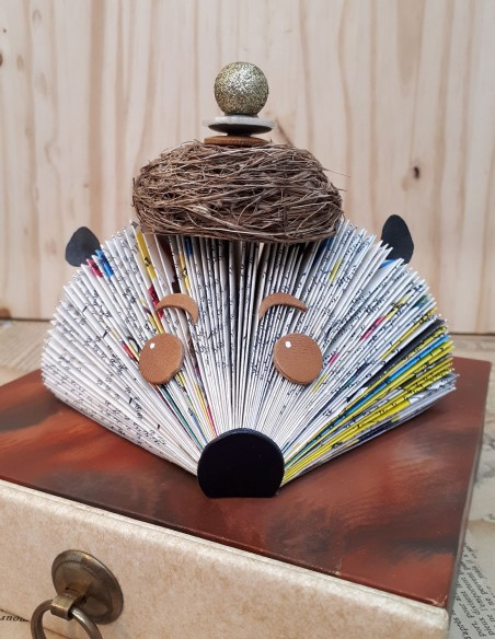 Hedgehog paper creation with bird's nest hat. Handmade creation in the bookbinding workshop.