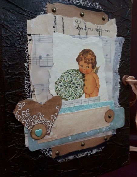 Handmade Cherub Notebook cover design by Nubiya Design. Combining paper and embroidery.