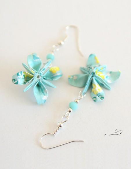 Pendiente de flor de anís origami.