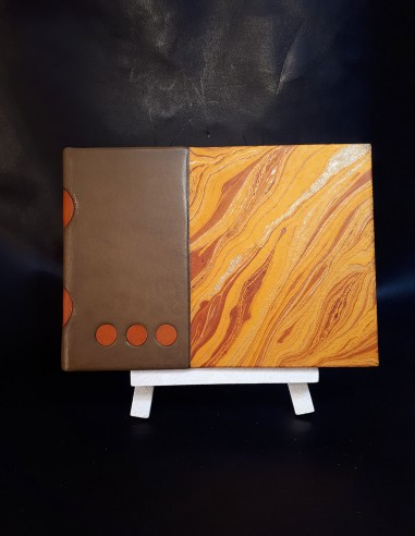 White notebook in brown sheepskin...
