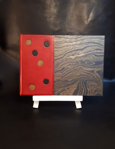 White notebook in red sheepskin...