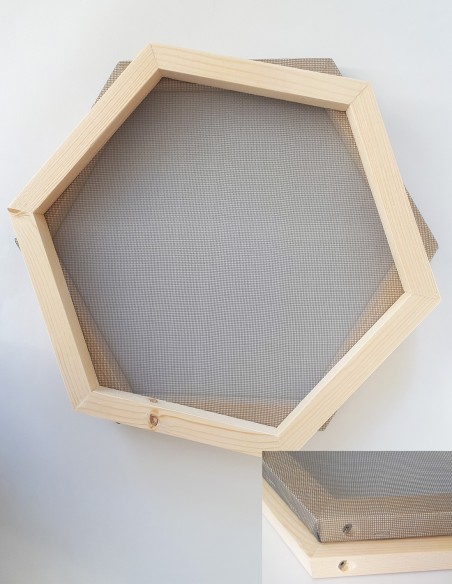 Recycled paper pulp sieve in hexagonal shape.